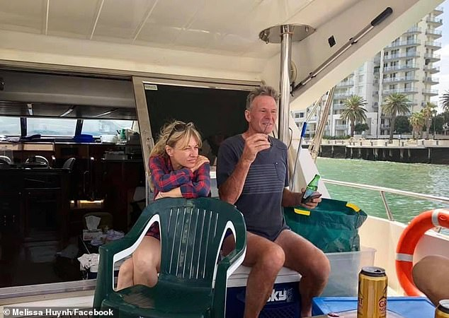 Sam Newman's wife Amanda Brown (left) was found dead in their Docklands apartment aged 50. She's pictured enjoying a day out on Port Phillip Bay with Newman in 2019
