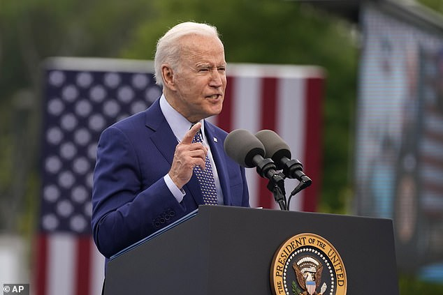 President Joe Biden speaks during a rally without his face mask in Georgia on Thursday