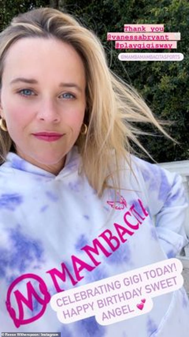 Celebrating: Leading lady Reese Witherspoon struck a pose in a hoodie, helping the collection to sell out in only a few hours