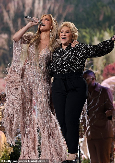 Fashion forward: She performed the iconic song while rocking a fringed and feathered Zuhair Marad pantsuit while her mother stepped out with a black and white polka dot top and black pants