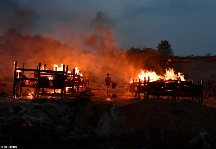 Bodies of Covid victims are burned at a cremation ground in Giddenahalli village on the outskirts of Bengaluru