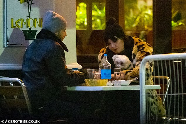 Patient pooch: The Maltese dog sat on Daisy's lap throughout the meal, joining the pair for their intimate meal at Lemonia
