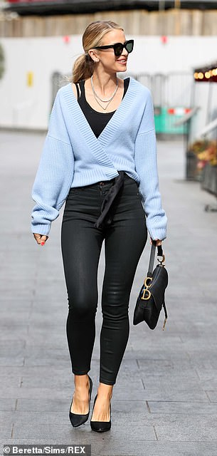 Strut: The star, 35, showcased her trim legs in a pair of black high-waisted jeans and stilettos as she walked down the street