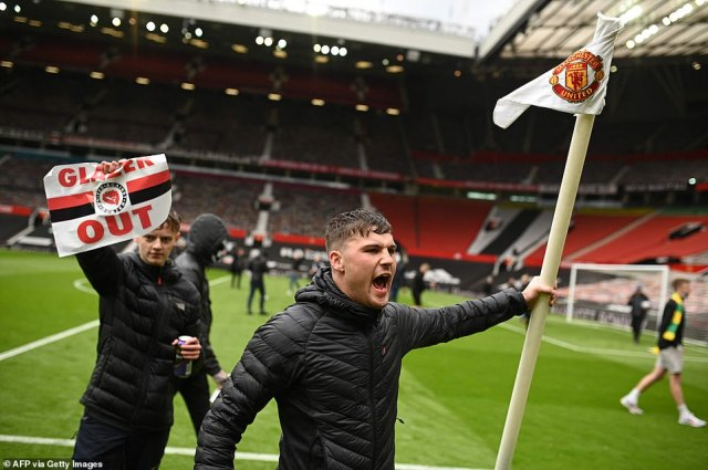 Armed with a can of Strongbow, two fans who stormed Old Trafford grabbed the corner flag before fleeing the stadium with it.Do YOU know the fan who grabbed the flag? Email amie.gordon@mailonline.co.uk