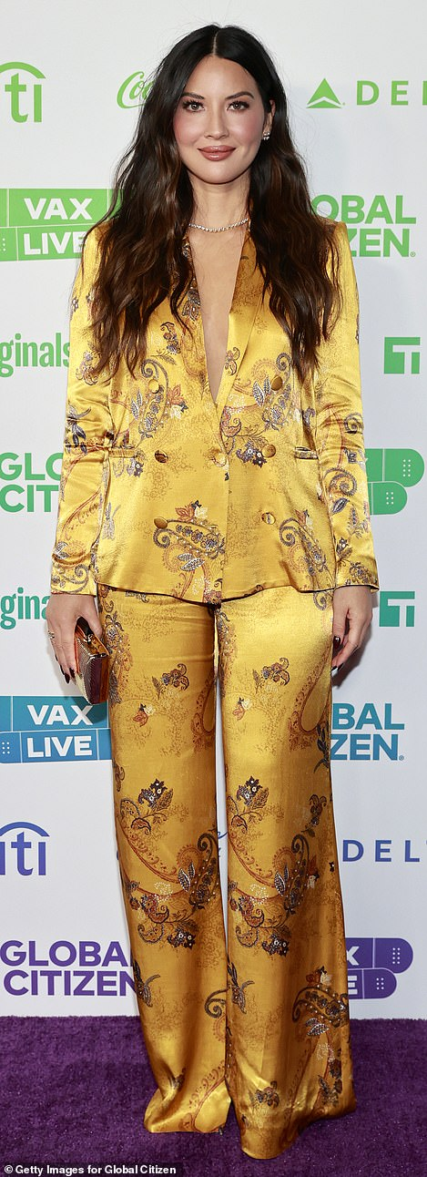 Olivia Munn opted for primary colors with a pajama-like yellow satin suit covered in elegant yet sparse paisley patterns
