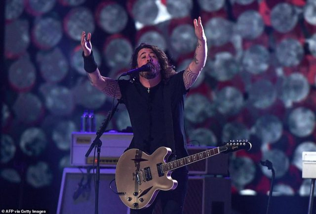 """""""We ain't out the woods yet. But let me tell you, I'm a firm believer and idea that music should be shared with people,"""" Foo Fighters frontman Dave Grohl (pictured) said. """"Let's work as hard as we can to make sure we can do this every night'"""