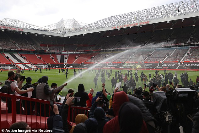 Shocking scenes saw fans pour onto the pitch at Old Trafford after breaking into the ground