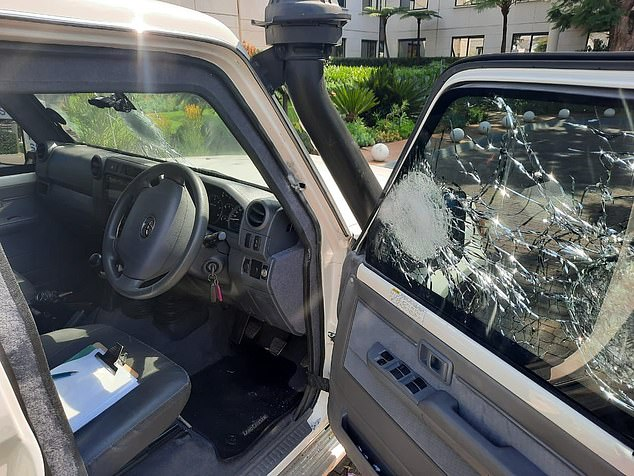 At least a dozen gunshots are heard for the first time as a car stands alongside security expert Leo on the N4 motorway in the capital Pretoria.  The targeted vehicle is shown above and below