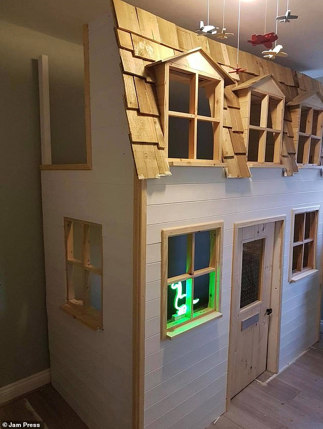 Danielle Jade Ahmed, 29, from Wrexham, Wales, asked her fatherDarren Evans, 53, to build a house bed for her sonZair, two. Pictured: The DIY house bed