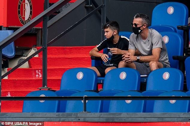 Van Persie is pictured alongside Shaqueel, 14, during a Feyenoord pre-season fixture in August