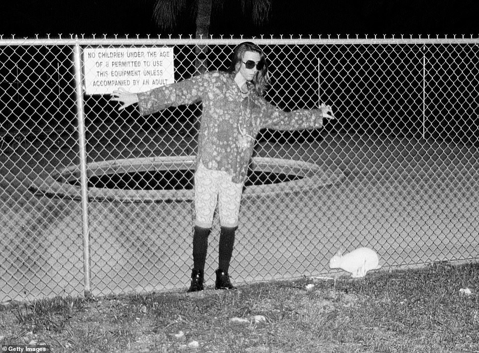 Marilyn Manson poses for photos on a school playground in 1990 in Ft. Lauderdale, Florida - the year after he had his heart broken by Rachelle
