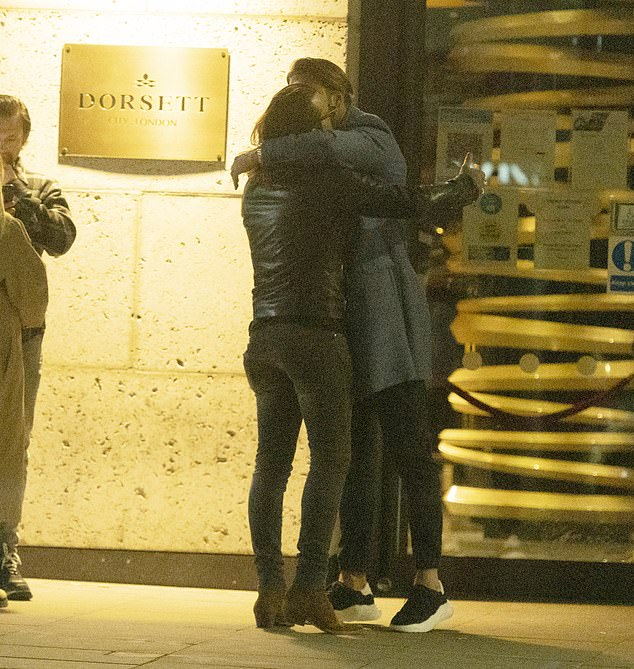 Saying goodbye: He chatted to James Lock before embracing him and heading towards a waiting car