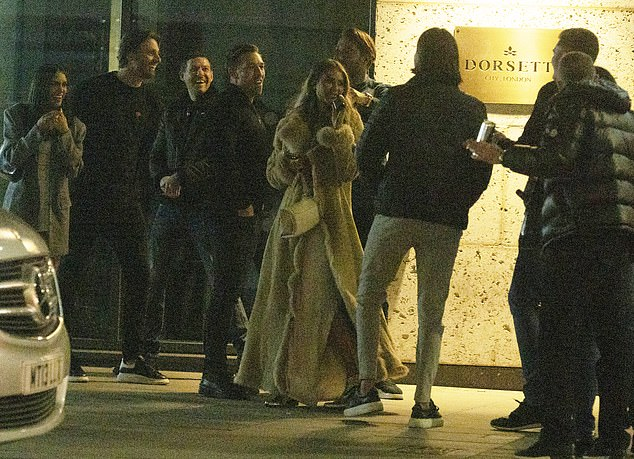 Change of mind: As she arrived outside the Jin Bo Law bar in Aldgate, the star appeared to stop and talk to people milling about outside before turning around and leaving