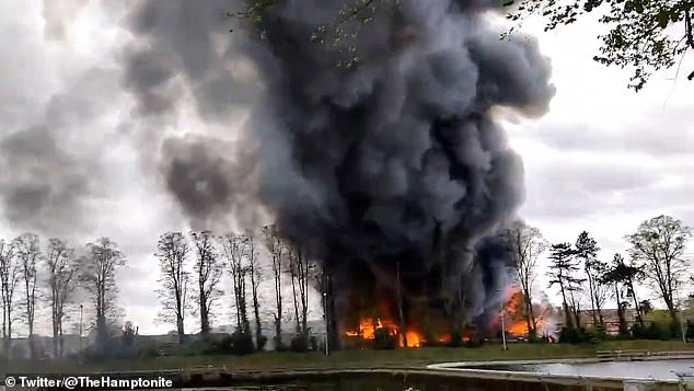 Those living nearby were warned to close their windows after the blaze erupted at the Hampton Boat Sheds at around 5.14pm, with pillars of smoke seen across south west London