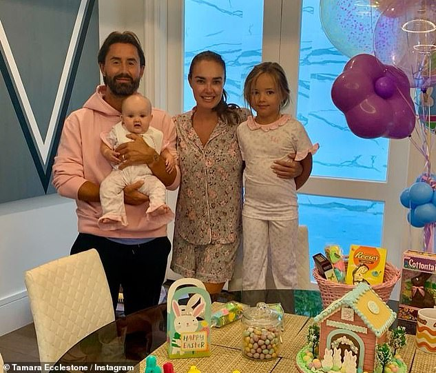 Happy family: The couple, alongside their daughters Sophia Serena, rented out chic new digs in LA (the family pictured in the house)
