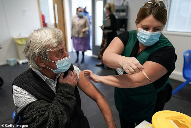 The County Durham town has trailing the national average for first doses of vaccinations but is ahead on second jabs. Pictured:Derek Thomas receives thevaccine at the Darlington Arena Vaccination Centre