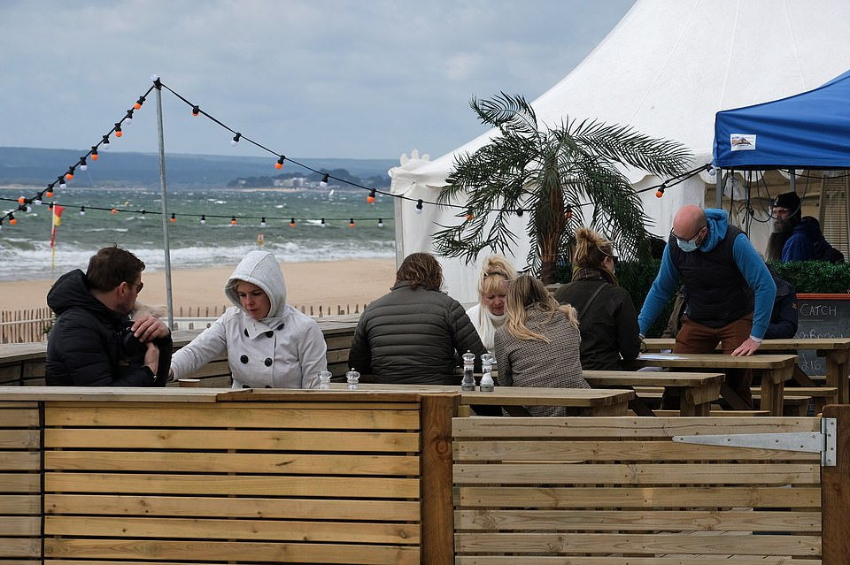 Punters wrapped up warm at restaurants along the beach in Bournemouth