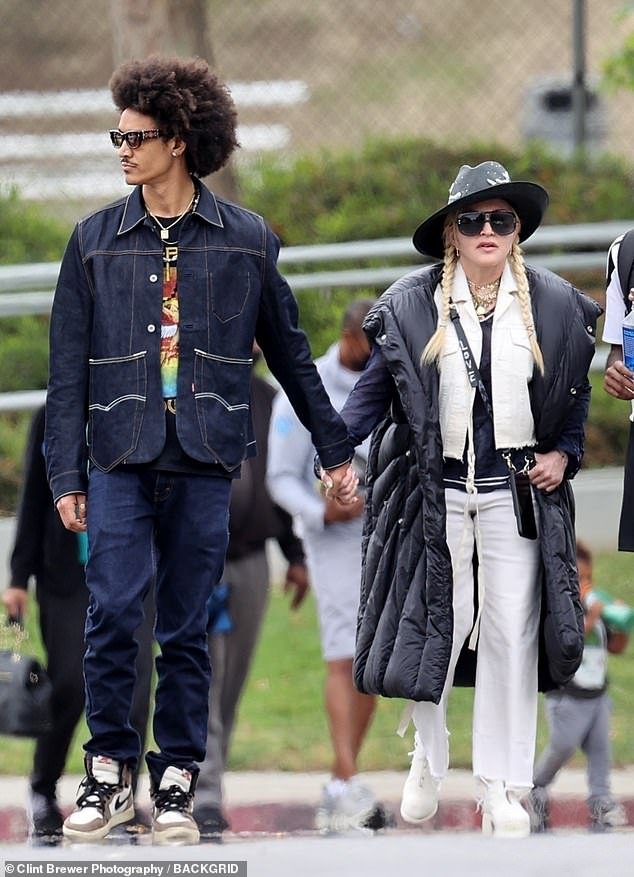 Joined at the hip: Madonna and her toyboy were seemingly joined at the hip