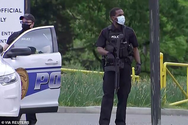 Officers from the Fairfax County Police were on site managing traffic around the heavily guarded main entrance to the agency, about 10 miles from Washington D.C.