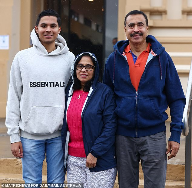 Commerce and law student Rishab Jain (left), from Ryde in north-west Sydney, said the ban was not racist but medically necessary. He is pictured with his mother Geetika and father Rajesh