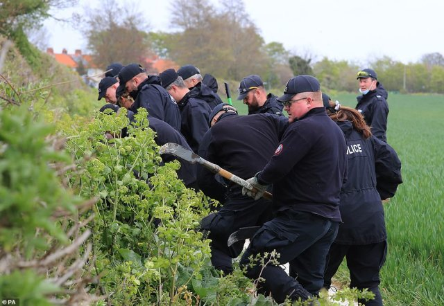 Kent Police search officers continue their search of fields near the scene where PCSO Julia James was killed at Akholt Wood