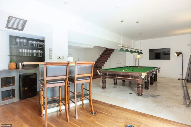 Game time:Boasting five bedrooms and five bathrooms, the mansion spans 5,000 square feet across two floors, and includes a games room complete with pool table