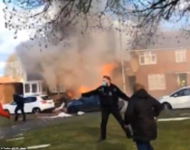Dramatic video shows flames and smoke billowing from the house in Ashford, Kent as police urge passers-by to stay away