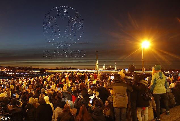 Crowds in Saint Petersburg, Russia watch drones form the Euro 2020 logo last weekend