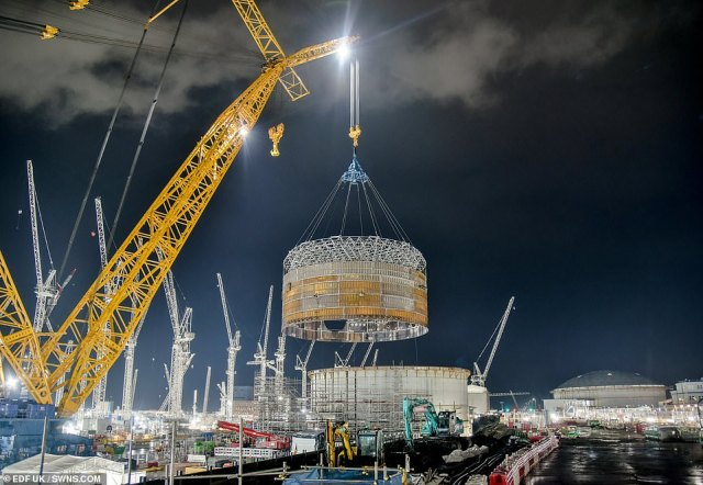 These impressive pictures capture the moment the world's largest crane lifts a massive steel ring at a UK power station