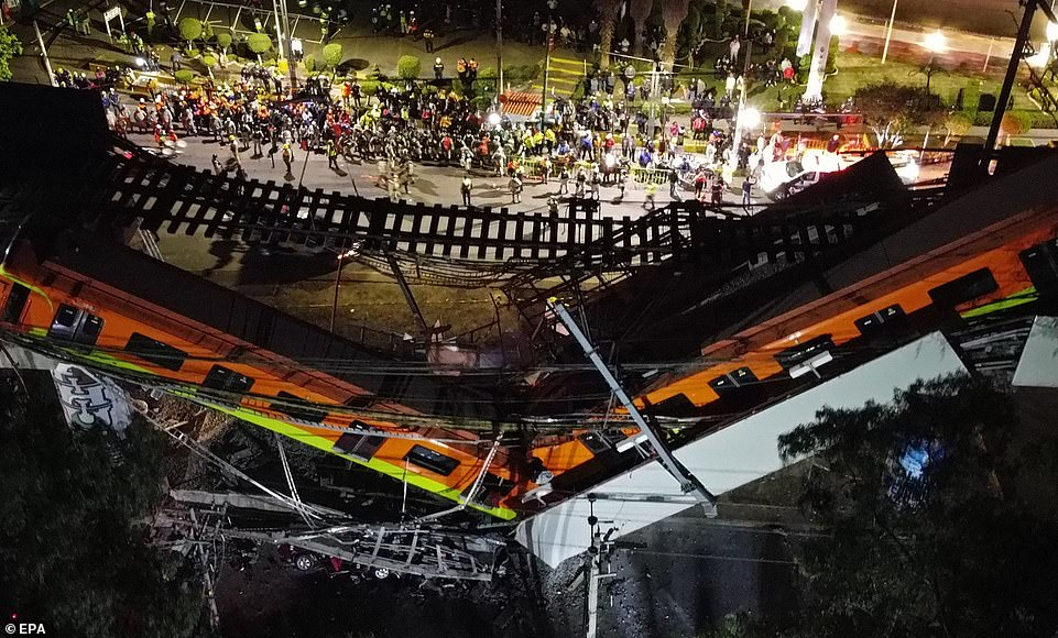 An aerial view of the collapsed bridge shows how the train fell on to the street below, killing at least 20 people