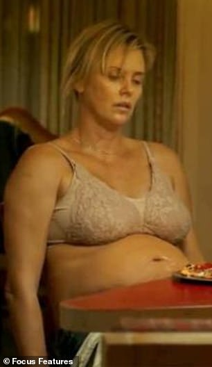 Mental health battle: Charlize Theron said she went into depression after putting on some 50lbs to play a mother on the brink in Tully