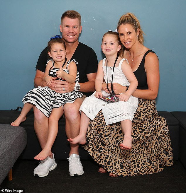 Warner (left) remains separated from his family back home in Australia. He's pictured with wife Candice and their two eldest daughters Indi and Ivy Mae