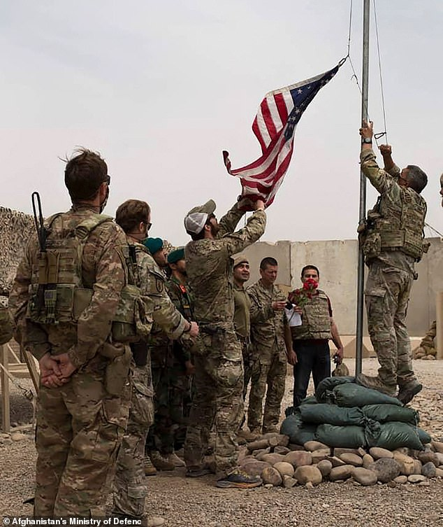 The Defense Ministry said just over 100 Taliban fighters were killed in Helmand, but did not give details of the losses of Afghan forces (above: The American flag was removed during the discount of May 2)