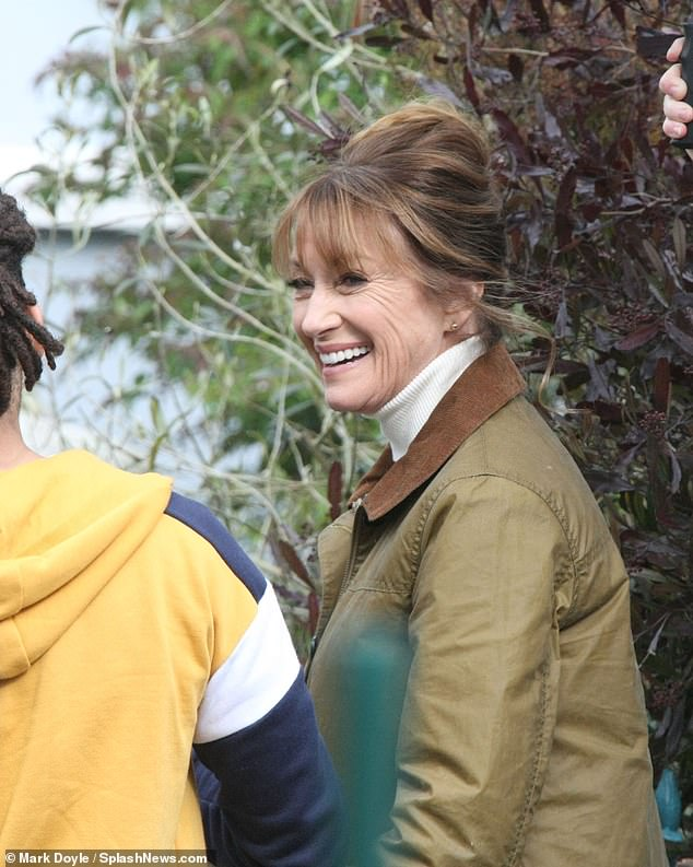 Happy: Jane shared a light moment with a young actor on set