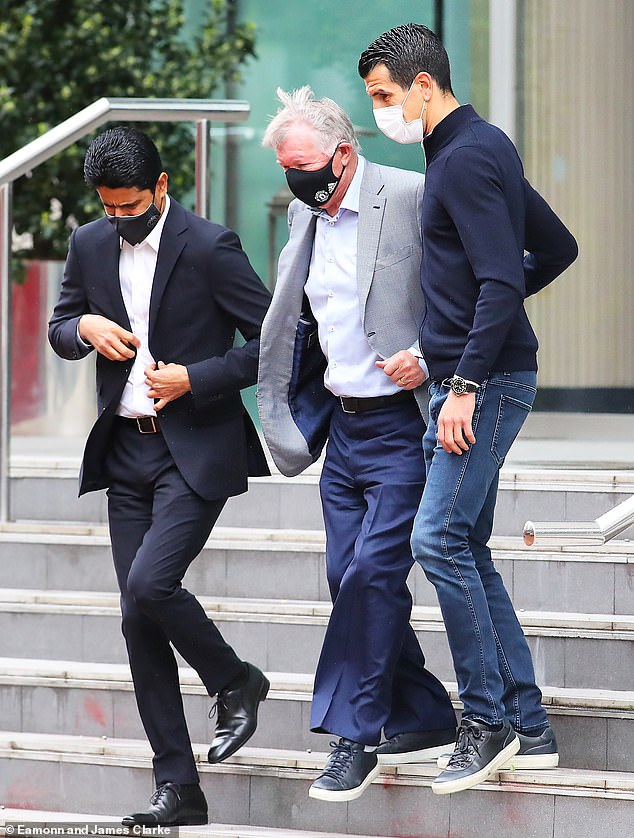 After his fleeting stay, Ferguson was seen leaving next to PSG president Nasser Al-Khelaifi (L)