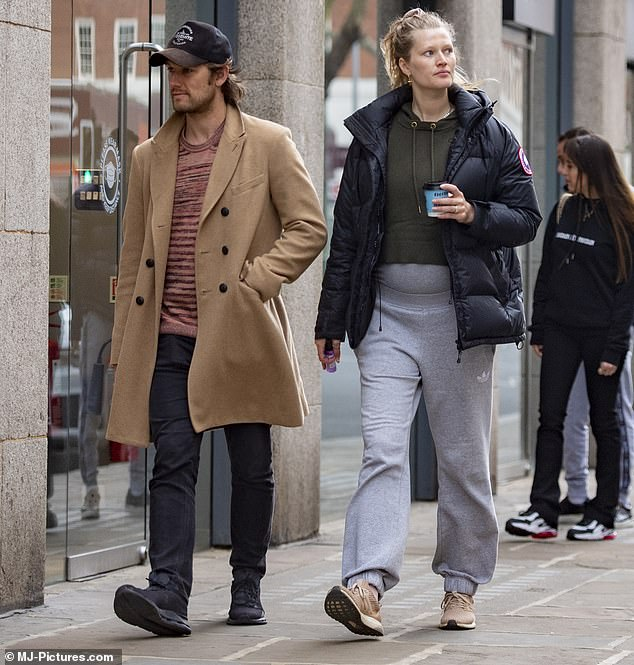 Out: Pregnant Toni Garrn opted for a casual outfit and decided not to wear makeup on Tuesday as she went shopping for baby essentials in London with her husband Alex Pettyfer.