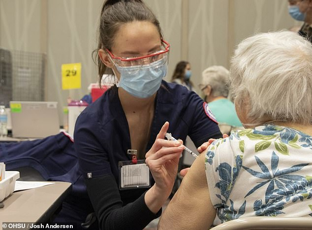 The Biden administration will announce on Tuesday a new plan to send COVID-19 vaccine doses directly to doctors in rural areas to help convince vaccine hesitant Americans to get the jab. Pictured: People 80 and older began receiving COVID-19 vaccinations at the Oregon Convention Center, February 10