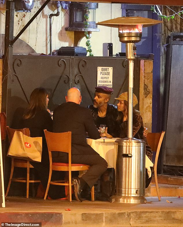 Fresh air: The couple were enveloped in conversation as they chatted with friends at a table placed along the street to comply with Los Angeles County's COVID-19 outdoor dining restrictions