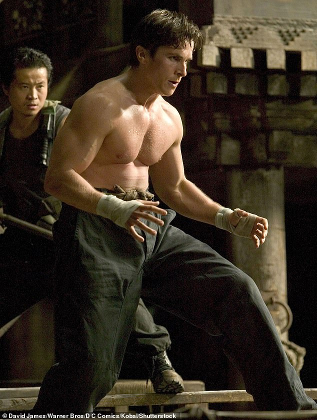 Building muscle: Just six months after The Machinist, Bale appeared in Batman Begins and had to get his weight back up to 180lbs. Pictured, on the set of the superhero film