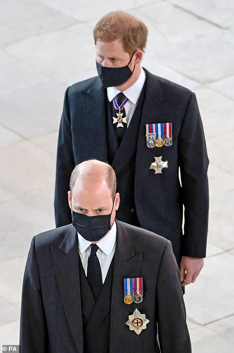 Finding Freedom is being updated with new chapters which will cover their tell-all interview with Oprah Winfrey, the allegations that Meghan, 39, bullied royal staff - which she denies - and the death of Prince Philip (pictured: Harry and William at the funeral)