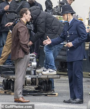 Introduction: Harry and David appeared to film a scene where their characters introduce themselves to each other as they were spotted shaking hands