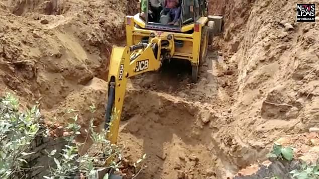 Rescuers used excavators to dig a corridor to help the frightened calf escape after it fell into the well on Sunday night