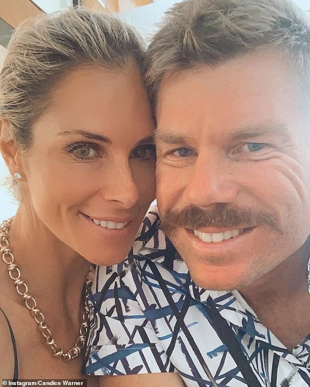 David Warner (pictured with his wife Candice) his Sunrisers Hyderabad teammates have also been plunged into a four day lockdown after one of their players, Wriddhiman Saha, returned a positive COVID-19 test on Tuesday