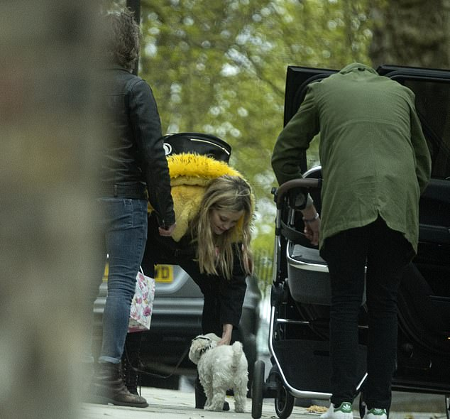 That's my boy: Laura also gave her beloved dog Mick some attention