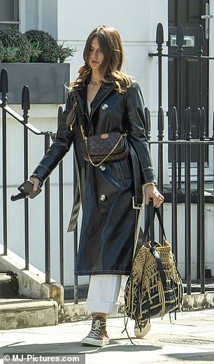 Loaded Down: Amelia also wore a Louis Vuitton bag over her toned torso for the walk