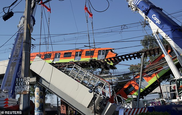 Cable wires were place on a train car (left) to keep it from crashing to the ground while another wagon (right) dangles from the track
