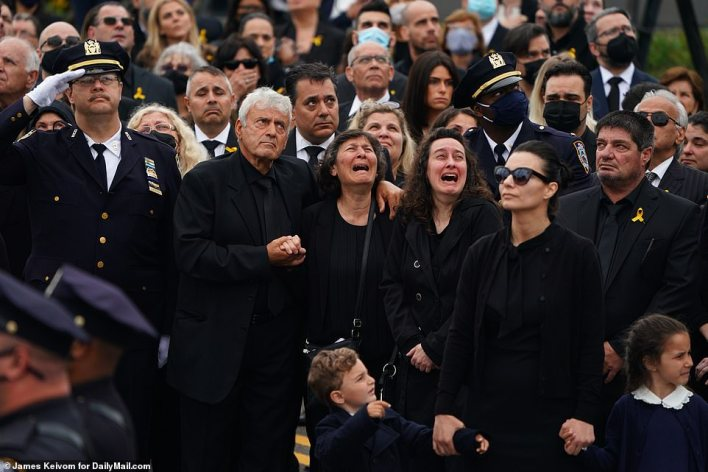 Mourners become emotional as they bid farewell to the veteran cop at his funeral service Tuesday in New York