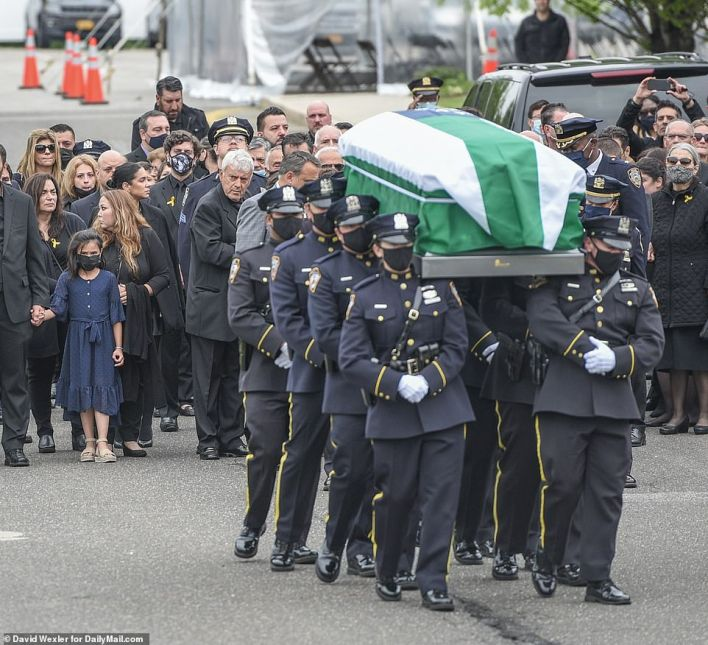 NYPD pall bearers carry the casket out of the church after the funeral services for the NYPD cop killed in the line of duty by an apparent drunk driver