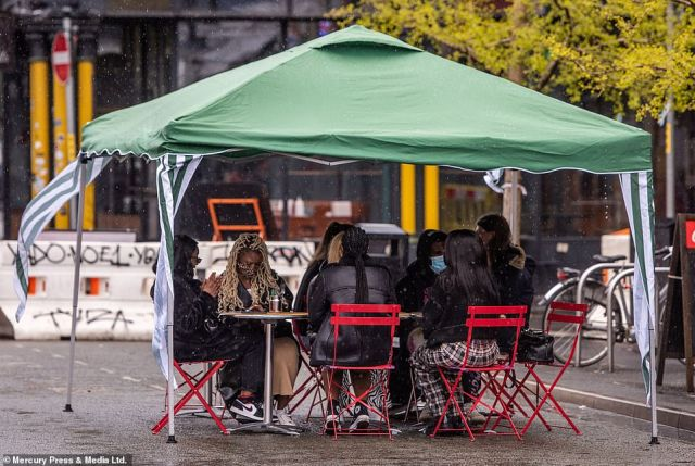 Diners make the most of the Bank Holiday despite the weather in Manchester city centre yesterday