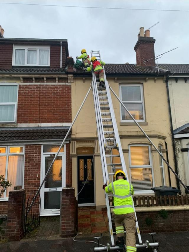 Firefighters in Gosport, Hampshire, braved the gusts to secure a roof which had become damaged in the high winds